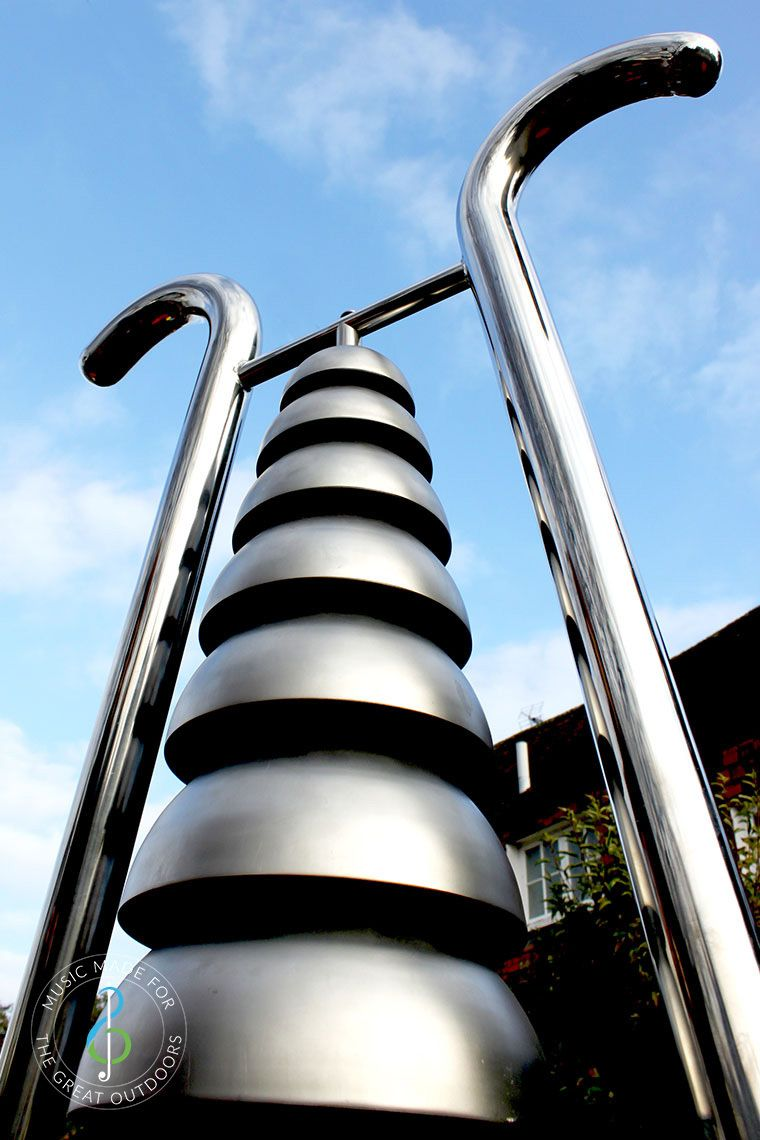 Close Up of Large Stainless Steel Bell Lyre Outdoor Chime