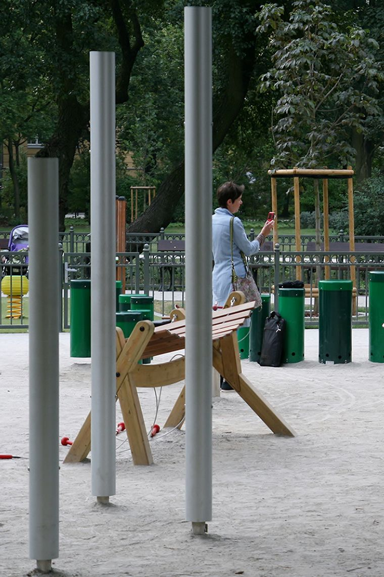 Three silver chimes installed in a children's playground