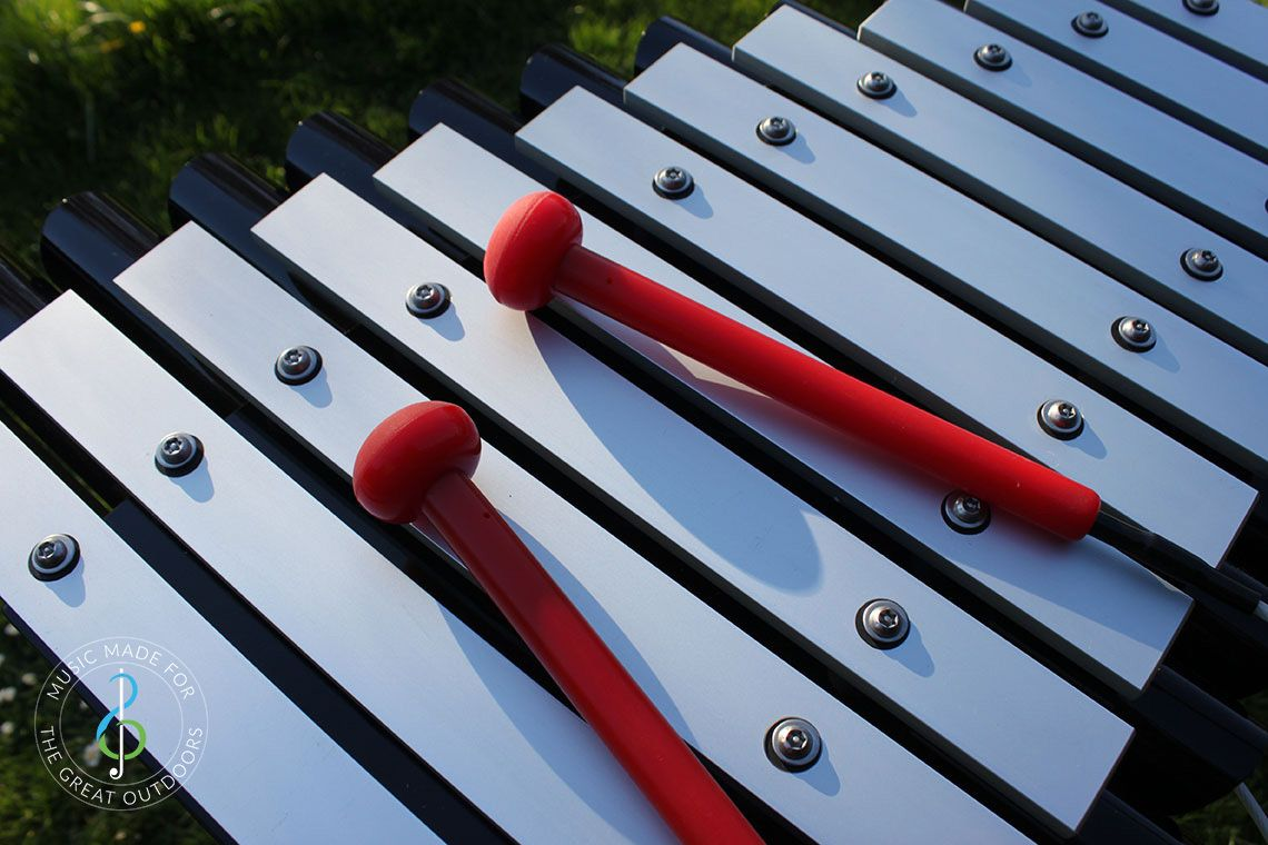 Close Up of Outdoor Xylophone Notes and Beaters