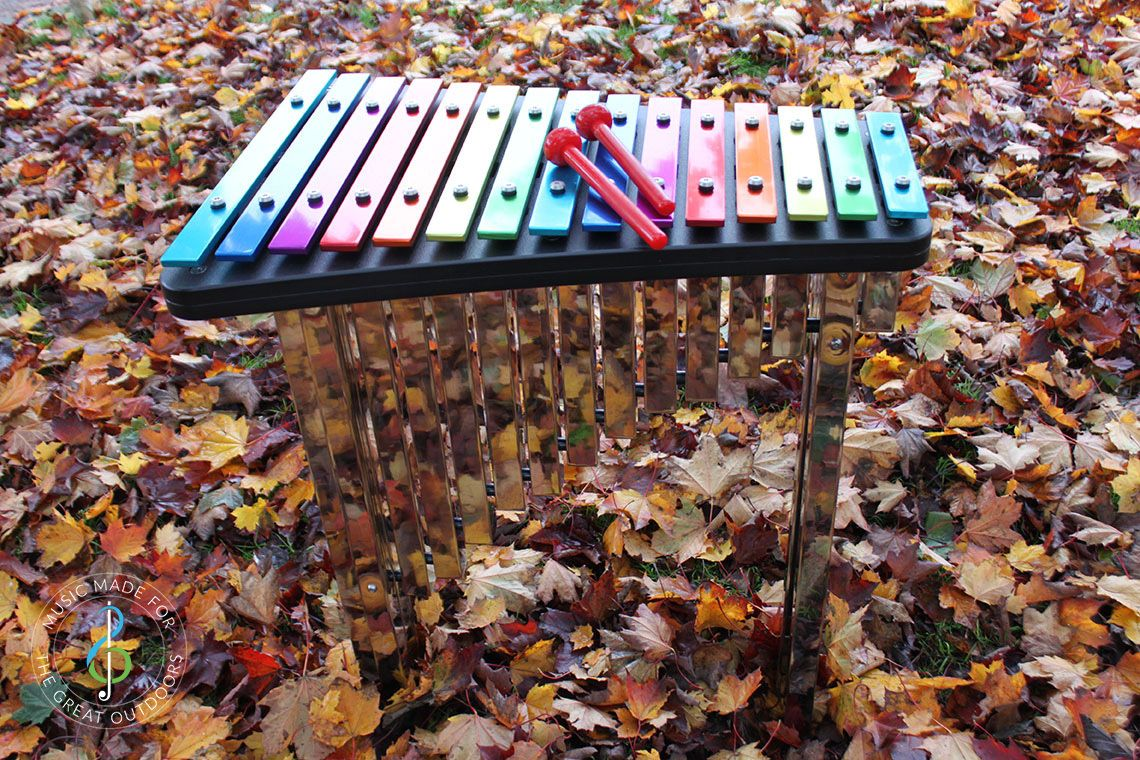 Rainbow Coloured Outdoor Xylophone in Park in Autumn