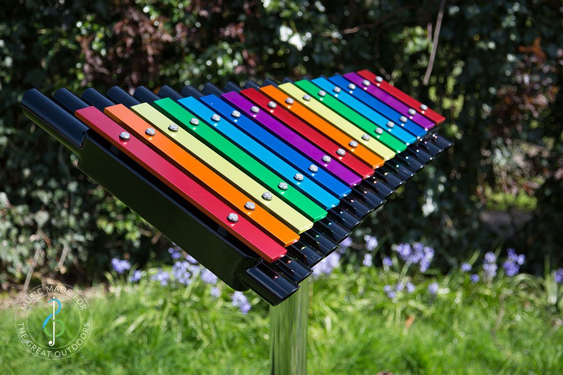 Large Xylophone Outdoors With Rainbow coloured Notes